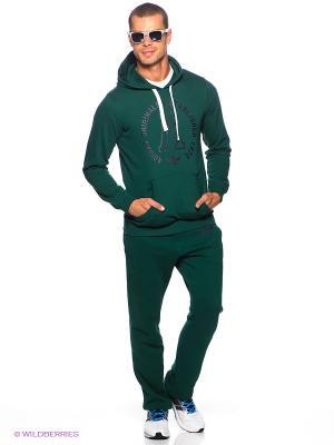 Брюки SLIM SWEATPANTS Adidas. Цвет: зеленый