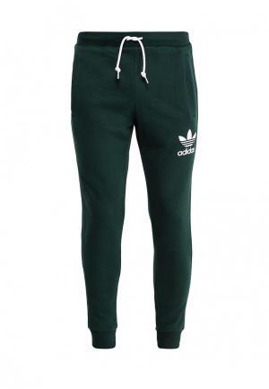 Брюки спортивные adidas Originals. Цвет: зеленый