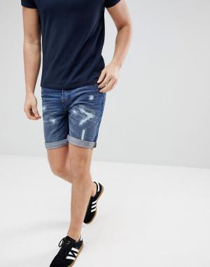 Produkt Джинсовые шорты с рваной отделкой. Цвет: синий