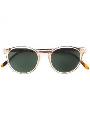 Солнцезащитные очки в круглой оправе Pantos Paris. Цвет: телесный