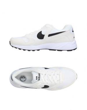 Низкие кеды и кроссовки NIKE. Цвет: белый