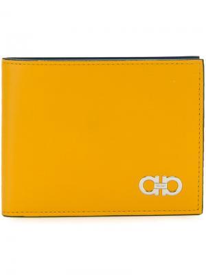 Складная визитница Salvatore Ferragamo. Цвет: жёлтый и оранжевый