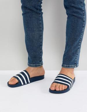 Adidas Originals Темно-синие шлепанцы Adilette 288022. Цвет: темно-синий