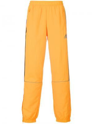 Спортивные брюки Gosha Rubchinsky x Adidas. Цвет: жёлтый и оранжевый