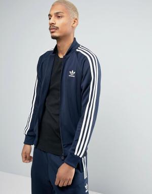 Adidas Originals Синяя спортивная куртка Superstar BK5919. Цвет: синий