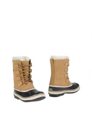 Полусапоги и высокие ботинки SOREL. Цвет: песочный