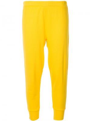 Зауженные спортивные брюки Sport The Upside. Цвет: жёлтый и оранжевый
