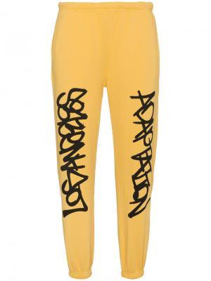 Спортивные брюки Graffiti Adaptation. Цвет: жёлтый и оранжевый