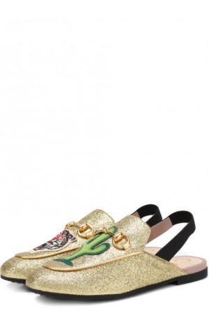 Кожаные сабо с глиттером и пряжкой-трензелем Gucci. Цвет: золотой