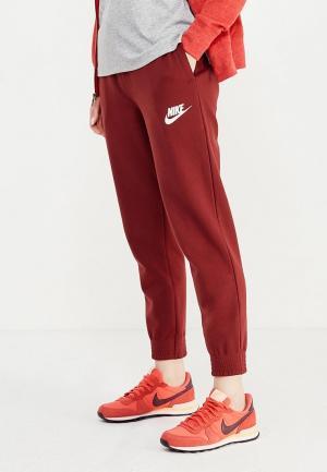 Брюки спортивные Nike. Цвет: бордовый