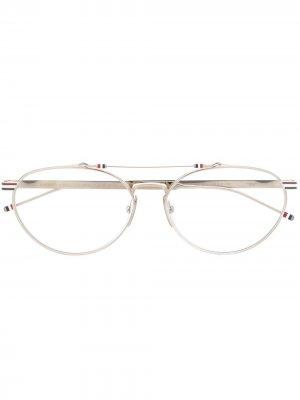 Очки в овальной оправе Thom Browne Eyewear. Цвет: серебристый