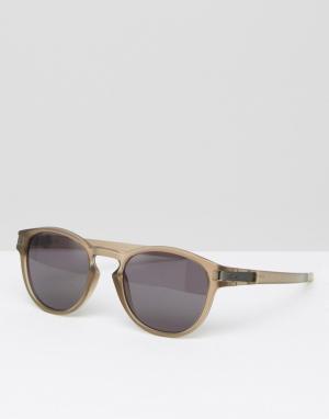Солнцезащитные очки в круглой оправе Oakley. Цвет: коричневый