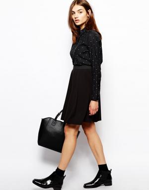 Короткая расклешенная юбка из крепа BZR. Цвет: черный