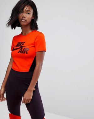 Укороченная оранжевая футболка Nike. Цвет: оранжевый