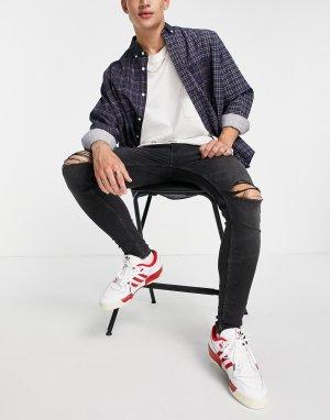 Эластичные джинсы с напылением и рваными коленями выбеленного черного цвета -Черный цвет ASOS DESIGN
