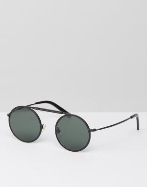 Черные матовые солнцезащитные очки в круглой оправе Han Kjobenhavn. Цвет: черный