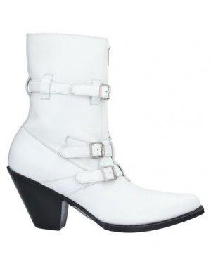 Полусапоги и высокие ботинки CELINE. Цвет: белый