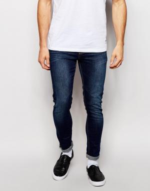 Темные супероблегающие джинсы ASOS DESIGN. Цвет: синий