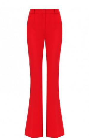 Однотонные расклешенные брюки из шерсти Michael Kors Collection. Цвет: красный