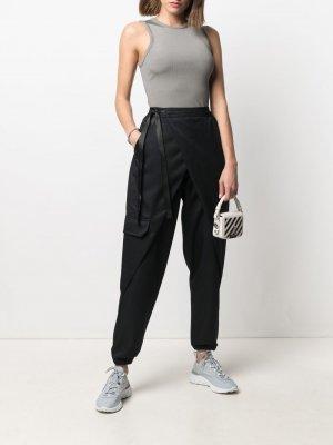 Зауженные брюки Nike. Цвет: черный