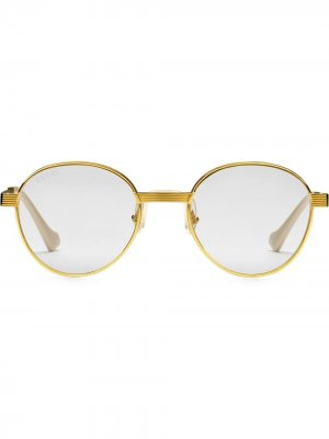 Солнцезащитные очки в круглой оправе Gucci Eyewear. Цвет: золотистый