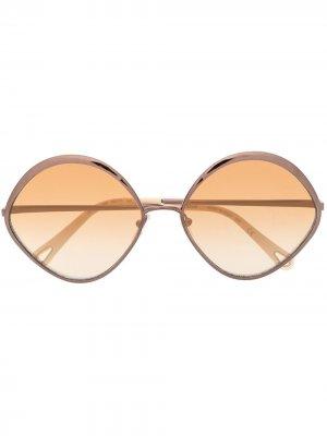 Солнцезащитные очки в круглой оправе Chloé Eyewear. Цвет: коричневый