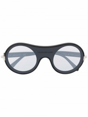 Солнцезащитные очки в круглой оправе Calvin Klein Jeans. Цвет: черный