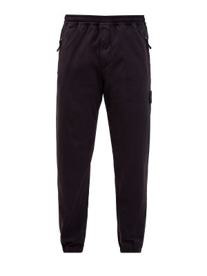 Однотонные брюки-джоггеры из хлопка и шерсти STONE ISLAND. Цвет: черный