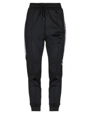 Повседневные брюки UMBRO. Цвет: черный