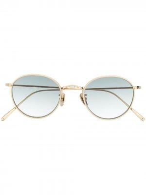 Солнцезащитные очки в круглой оправе Spektre. Цвет: золотистый