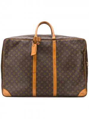 Чемодан с монограммами Louis Vuitton. Цвет: коричневый