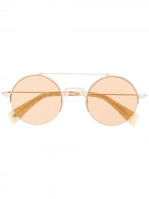 Солнцезащитные очки в круглой оправе Yohji Yamamoto. Цвет: золотистый