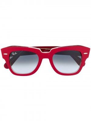 Солнцезащитные очки в круглой оправе Ray-Ban. Цвет: красный