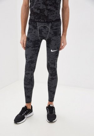 Тайтсы Nike M NP TGHT AOP. Цвет: серый