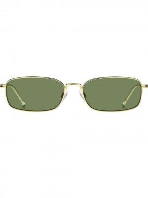 Солнцезащитные очки в овальной оправе Tommy Hilfiger. Цвет: золотистый
