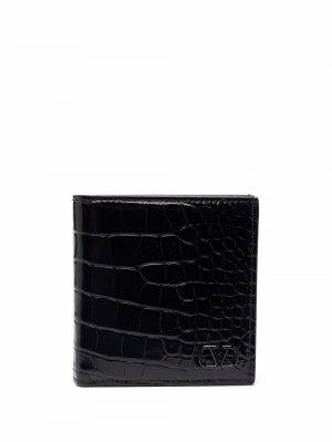 Бумажник с тиснением под кожу крокодила и логотипом Valentino Garavani. Цвет: черный