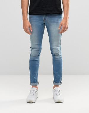 Светлые супероблегающие джинсы ASOS DESIGN. Цвет: синий