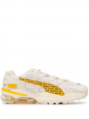 Кроссовки с контрастными вставками по бокам Puma. Цвет: нейтральные цвета