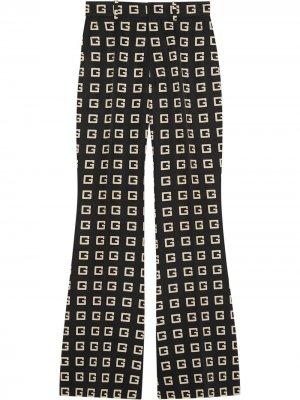 Расклешенные брюки с принтом G Gucci. Цвет: черный