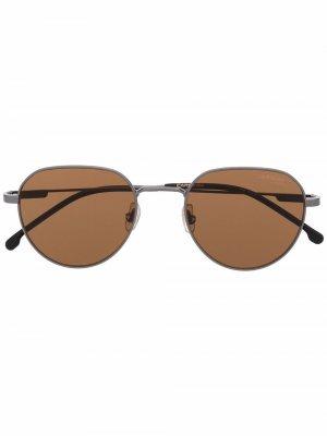 Солнцезащитные очки в круглой оправе Carrera. Цвет: серебристый