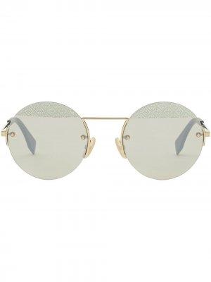 Солнцезащитные очки в круглой оправе Fendi Eyewear. Цвет: золотистый
