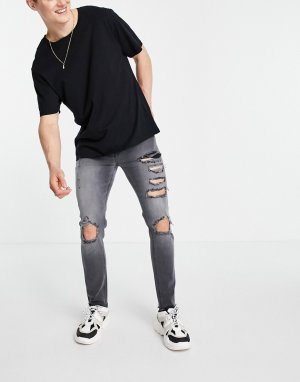 Черные выбеленные зауженные джинсы с большими рваными разрезами и необработанным низом штанин -Черный цвет ASOS DESIGN