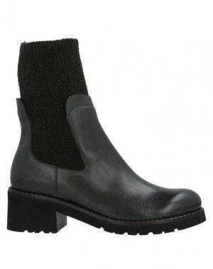 Полусапоги и высокие ботинки CALPIERRE. Цвет: темно-зеленый