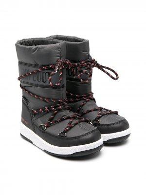 Зимние сапоги с полосатыми шнурками Moon Boot Kids. Цвет: черный