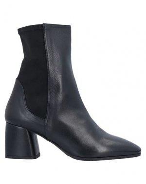 Полусапоги и высокие ботинки LORENZO MASIERO. Цвет: черный