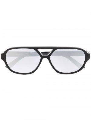 Солнцезащитные очки в круглой оправе Calvin Klein. Цвет: черный
