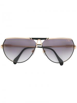 Затемненные солнцезащитные очки-авиаторы Cazal. Цвет: золотистый