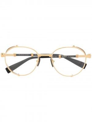 Очки в круглой оправе Balmain Eyewear. Цвет: золотистый