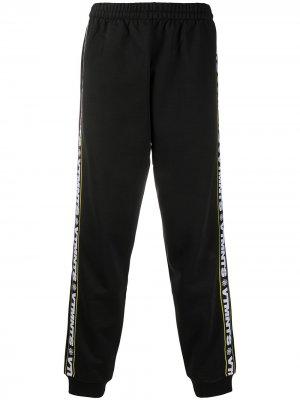 Спортивные брюки с логотипами на лампасах Vetements. Цвет: черный
