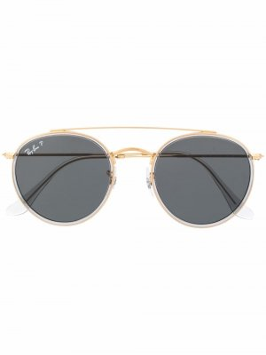 Солнцезащитные очки в круглой оправе Ray-Ban. Цвет: золотистый